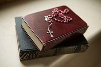 Rosary on bibles