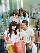 Family looking in shopping bag