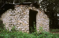 A stone hut or shed sits along side a small road in the settlement of Mukinje in the Plitvice Lakes National Park area. Croatia
