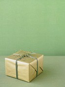 Christmas gift wrapped in gold paper (thumbnail)