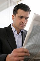 Businessman reading exchange quotation in the newspaper