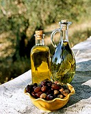 Olive oil with olives in open air (1)
