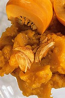 Pumpkin puree with garlic cloves and pumpkin quarters