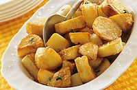 Fried potatoes, sprinkled with coarse salt