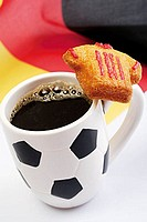 Coffee in mug with football motif