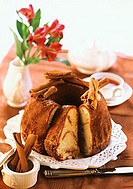 Ring cake with cinnamon, slices cut