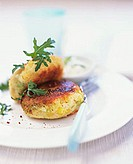 Vegetable burgers with sweetcorn and rocket