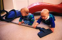 14 month old twin boys playing with hoover