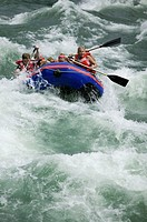 Group of people white-water rafting on river, elevated view