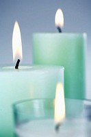 Three candles, close-up (focus on middle candle)