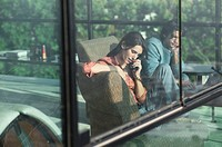 Reflection of couple with laptop and using telephone