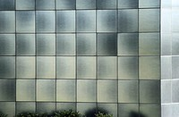 Building with reflective tiles