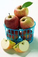 Fresh apples in plastic basket