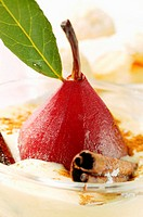 Pear in red wine with cinnamon in Madeira cream