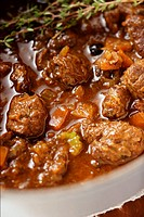 Venison ragout with thyme close-up