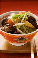 Vegetables and mushrooms cooked in wok on rice China