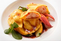 Ravioli with lobster filling on courgettes