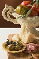Olives, sausage, Parmesan and tomatoes