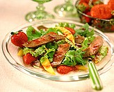 Green salad with beef and strawberries