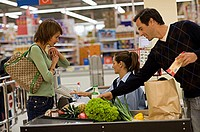 Young couple at the checkout in a supermarket