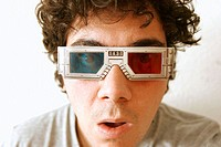 Man with 3D glasses looking to something surprised
