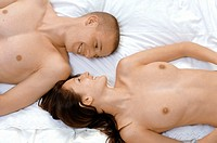 High angle view of a young couple lying on the bed