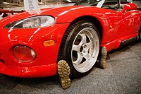Dodge Viper RT/10, 1994. The boots under the car make it look as someone has run over somebody. looks like being run over
