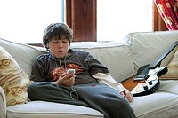 Twelve-year-old boy listening to his iPod.