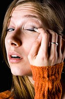 Woman applying eye make-up