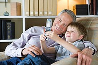 Boy and grandfather with camera phone