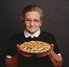 Senior woman holding pie