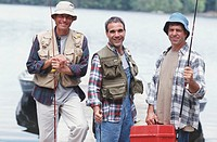 Three mature fishermen with gear, portrait