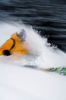Man skiing in power snow, side view (blurred motion)