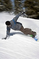 USA, Idaho, Sun Valley, young man snowboarding (blurred motion)