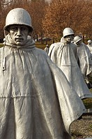 Detail of metal sculptural soldiers marching up a hill at the Korean War Veterans Memorial, Washington, DC, USA