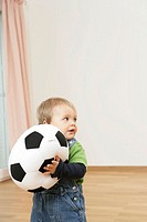 Baby boy holding a football