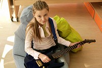 Girl holding an electric guitar