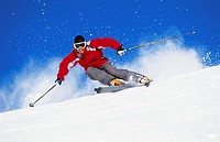 Female skier making turn on groomed slope