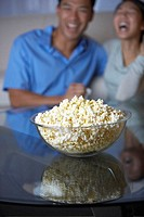 Bowl of Popcorn, Couple in Background
