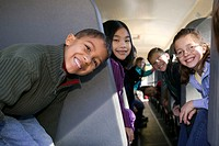 Group of young children riding the school bus, portrait