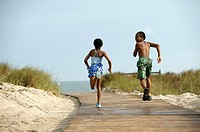 Kids running to the beach
