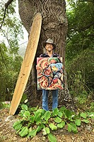 Man holding painting