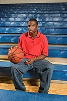 Teenage boy with basketball