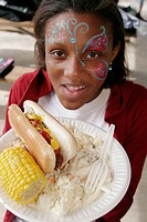 DFYIT Family Picnic, Black female, paper plate, hot dog, bun, corn on cob. Amelia Earhardt Park. Hialeah. Florida. USA.