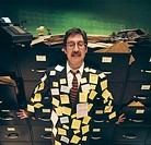Overworked businessman covered with post-it notes
