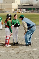 Young girls play softball