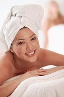 Asian woman with towels at spa, portrait.