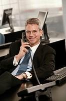 Businessman talking on telephone.