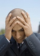 Businessman holding head