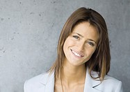 Young businesswoman smiling, portrait